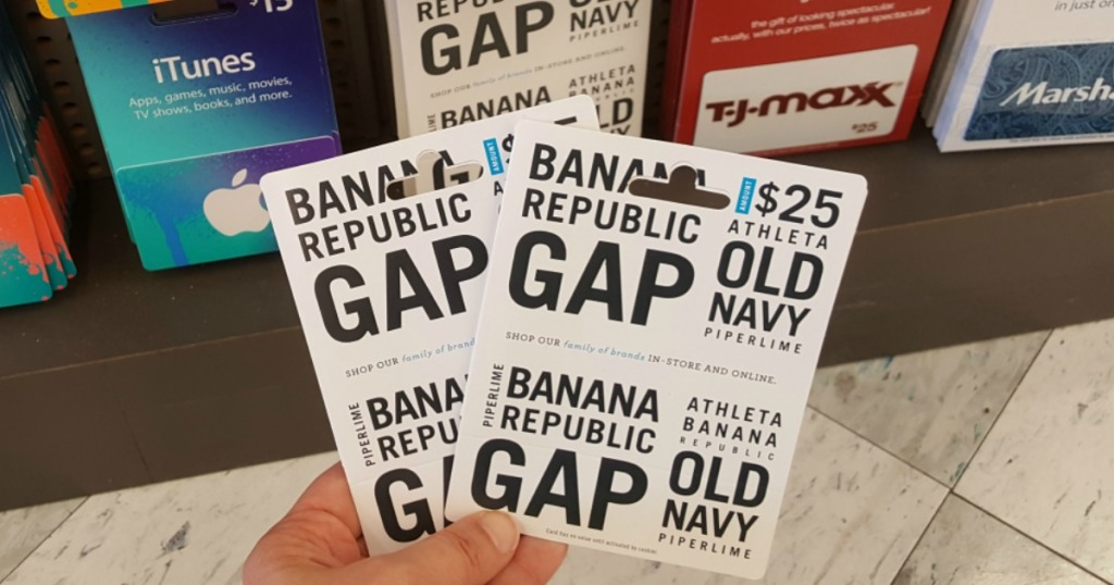 hand holding 2 gap brand gift cards