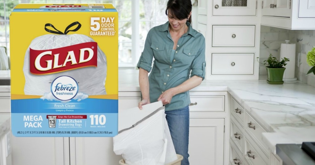woman using glad trash bags with box in corner