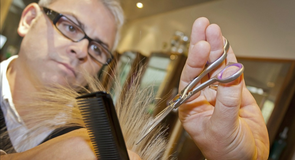 hair stylist trimming hair