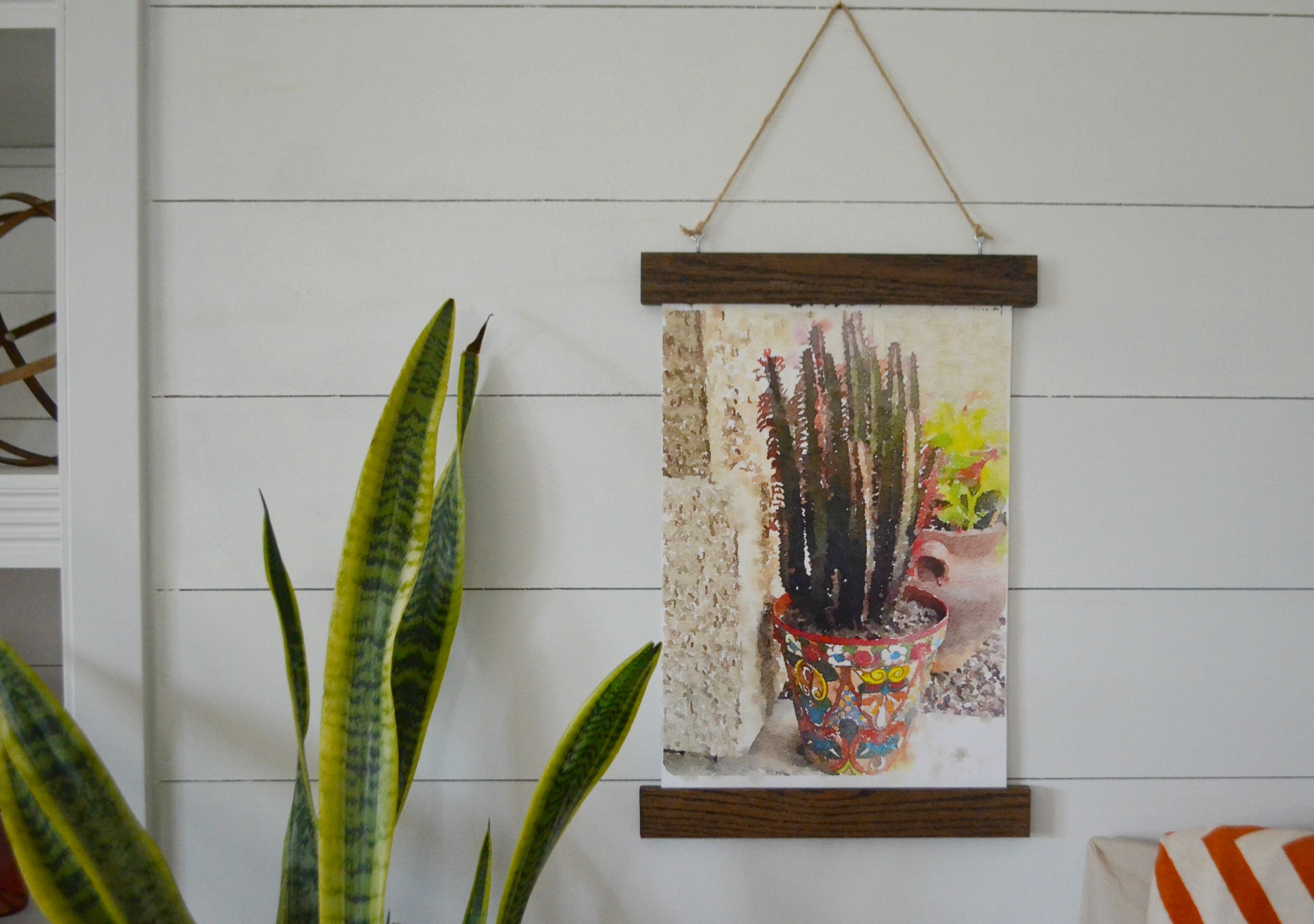 This art piece looks amazing against my shiplap wall!