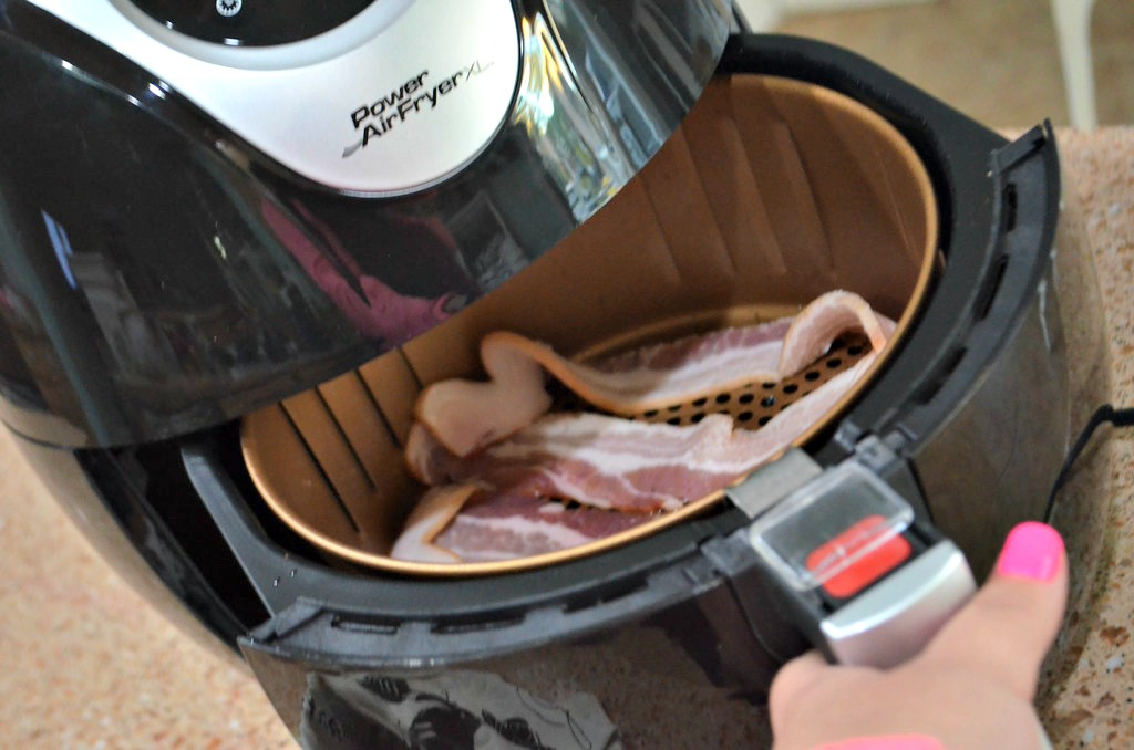 Cook a few slices of bacon at a time in the air fryer for best results.