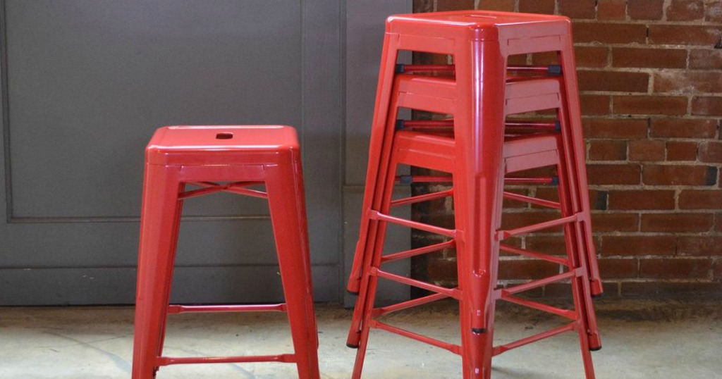 Red colored backless metal bar stools
