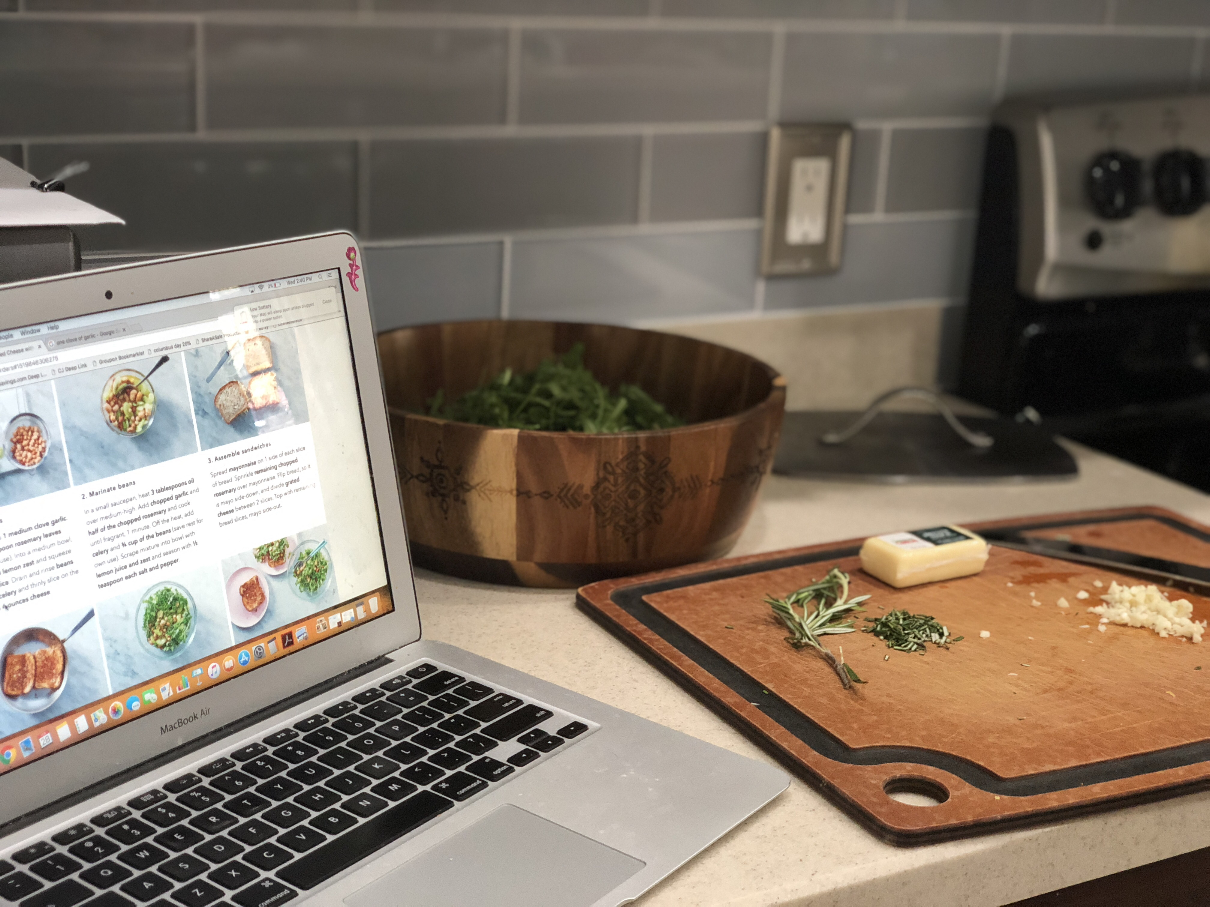 Martha and Marley Spoon deal - a laptop with recipes open on a counter top near a cutting board
