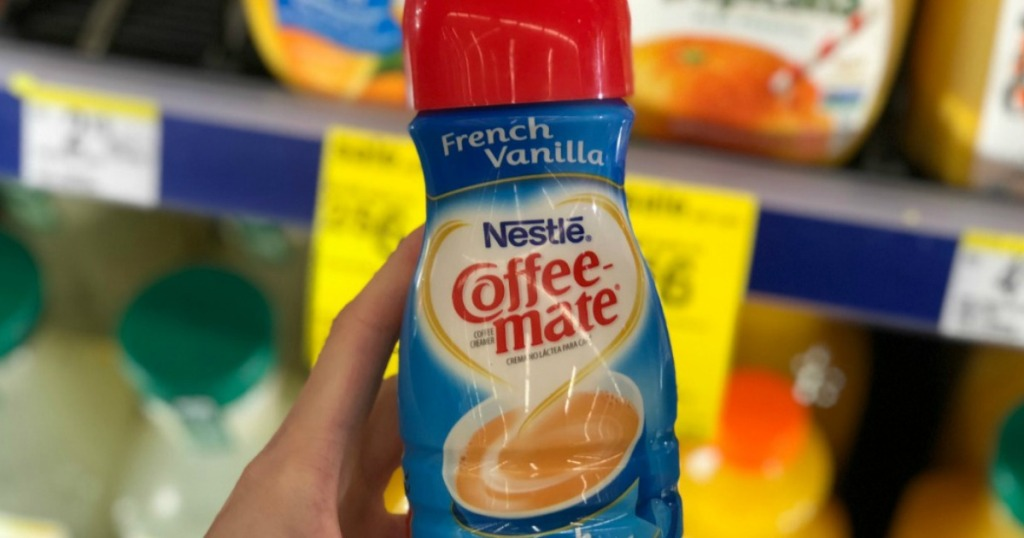 hand holding a bottle of coffee creamer in store