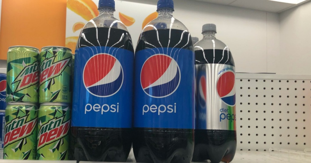two blue bottles of soda