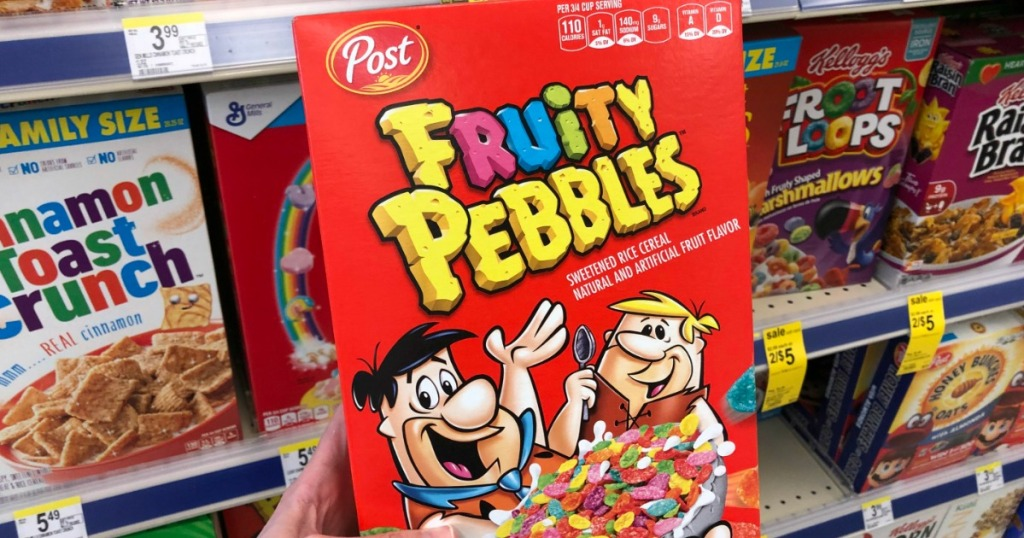 hand holding a box of Fruity Pebbles