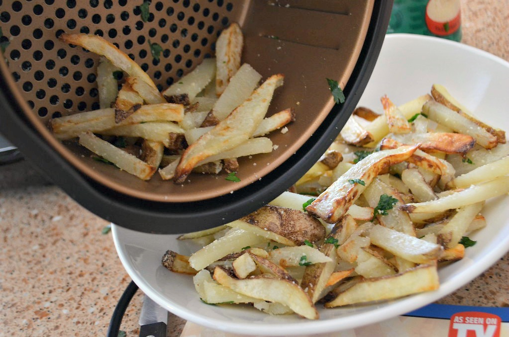 Tossed with Parmesan cheese and herbs, these air fryer french fries look as good as they taste.