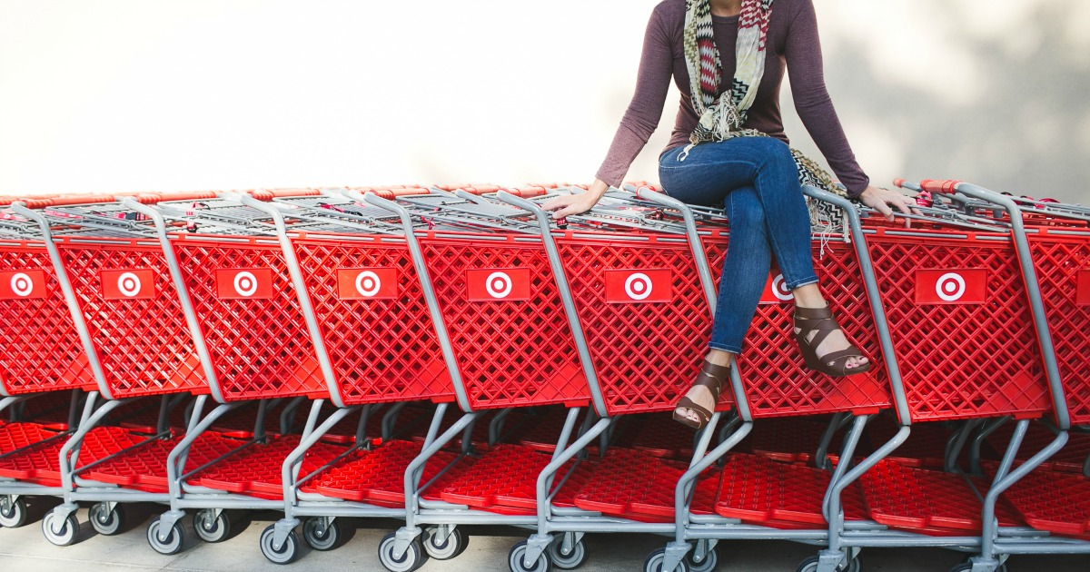 Target carts stacked together with woman sitting on top