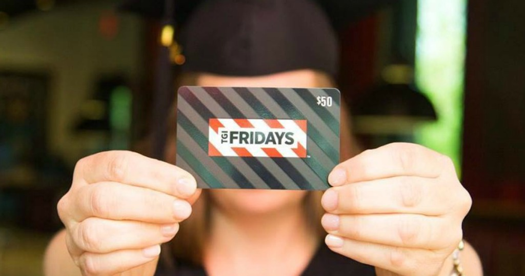 Grad holding gift card to TGI Friday's restaurant