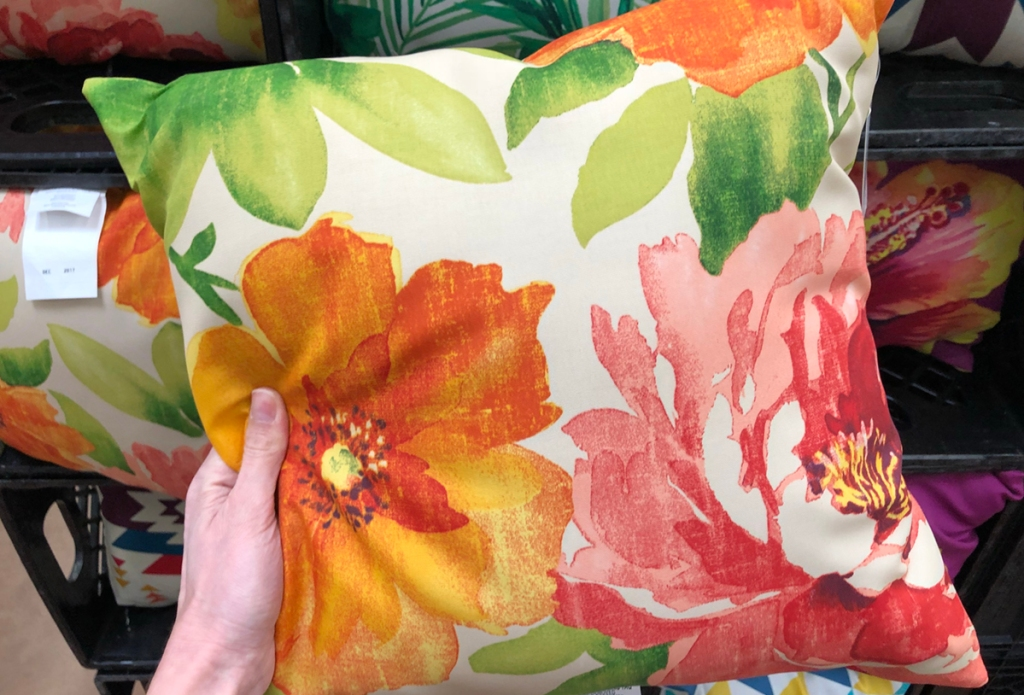 holding floral throw pillow