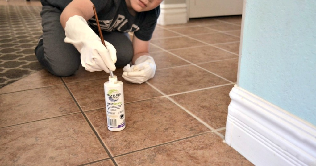 boy painting grout lines on tile floor - selling your home