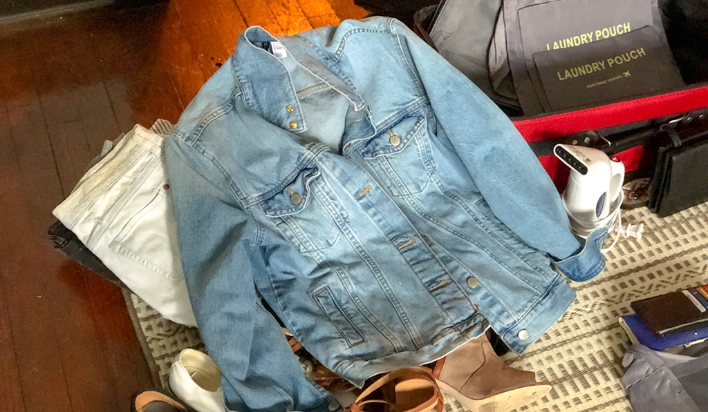 wear jackets and sweaters on the place to save space in your bag hip2save