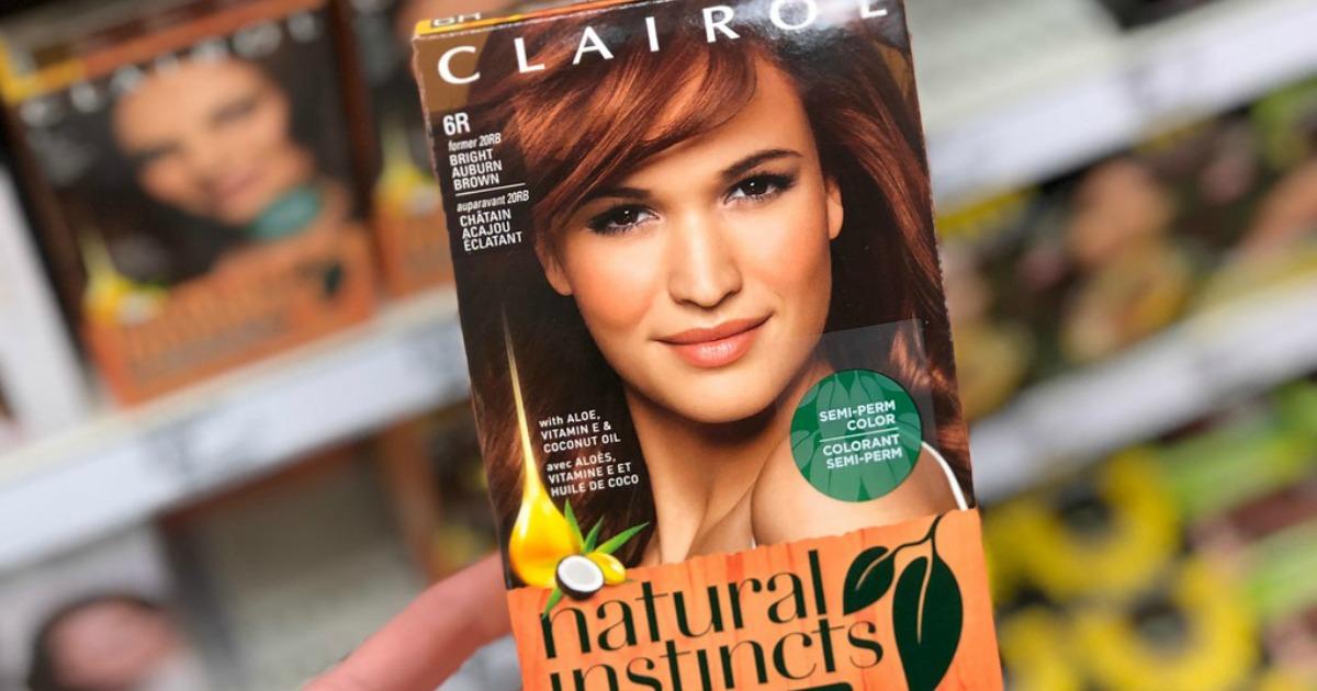 Hand holding a Clairol hair dye box