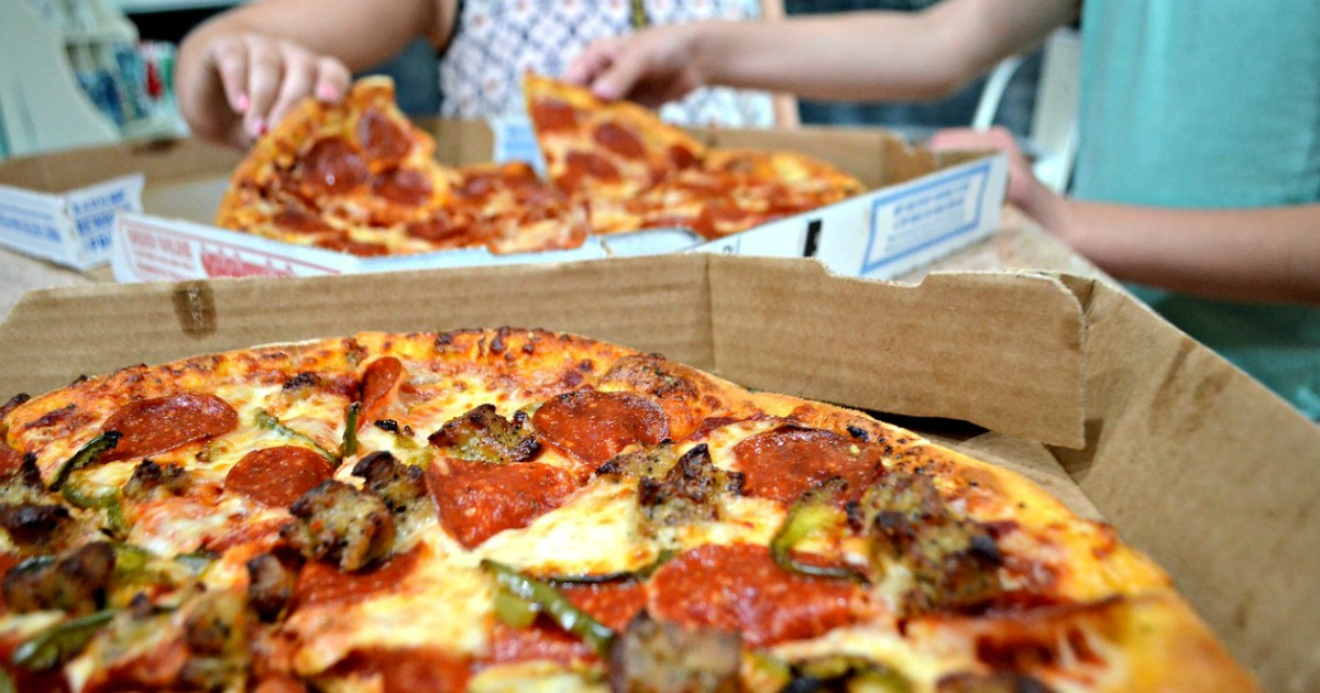 Domino's pizzas on dining table