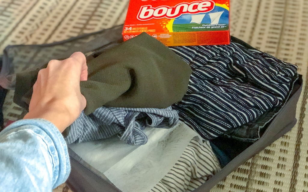 use dryer sheets to keep clothes smelling fresh hip2save