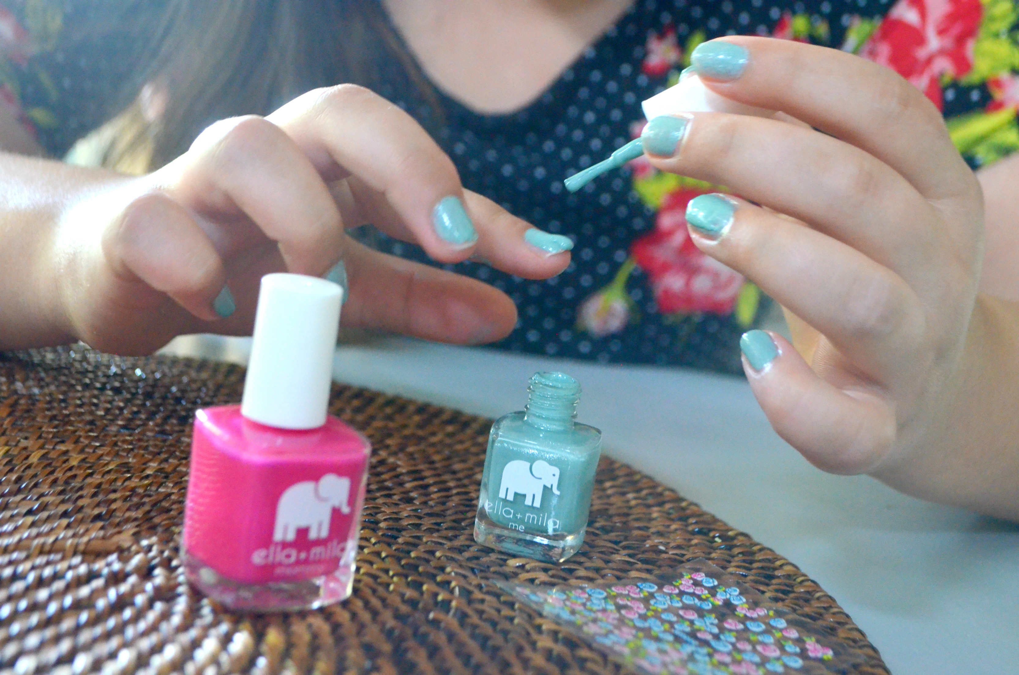 ella mila nail products deal - young girl painting her nails