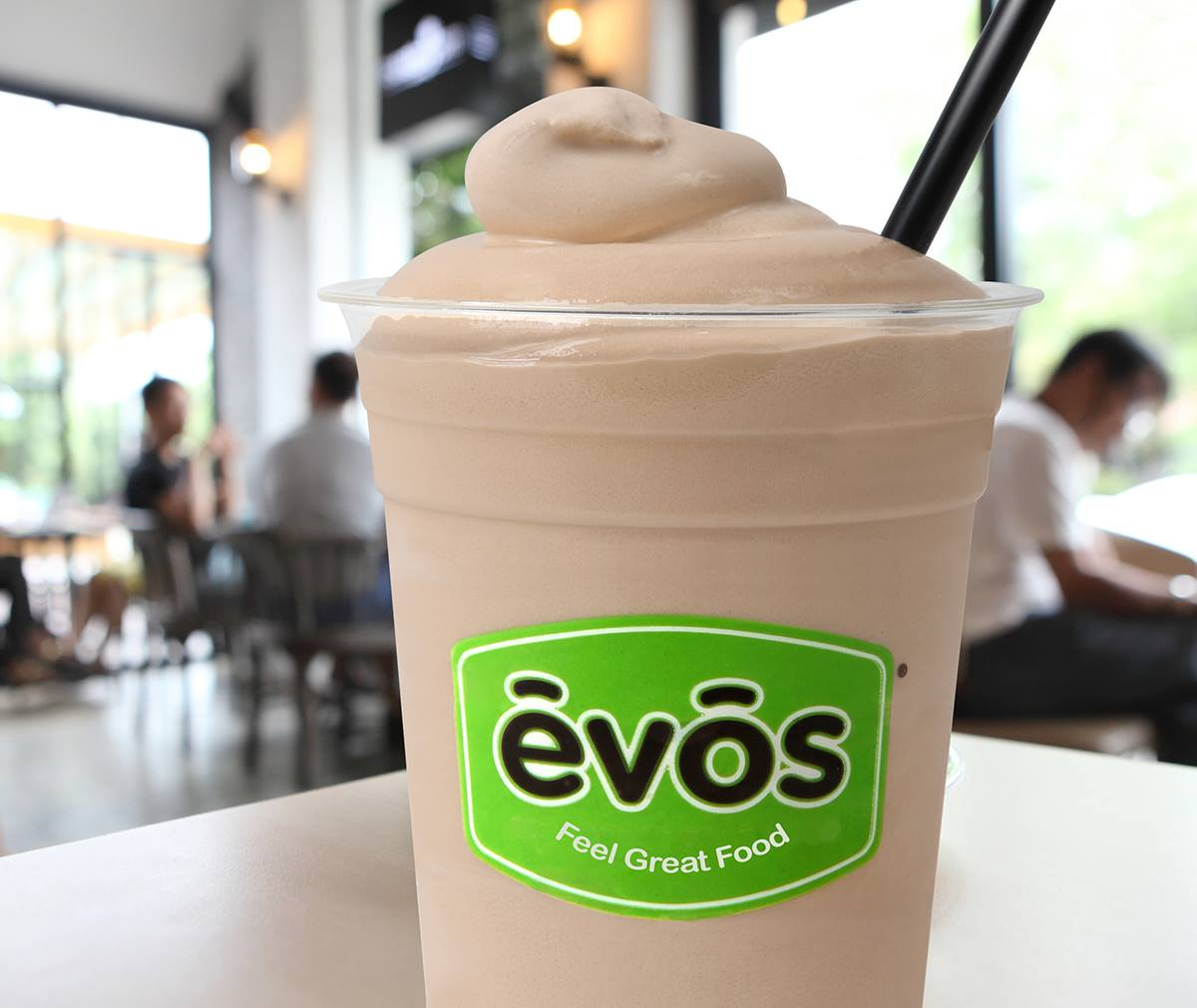 Evos drink with a straw