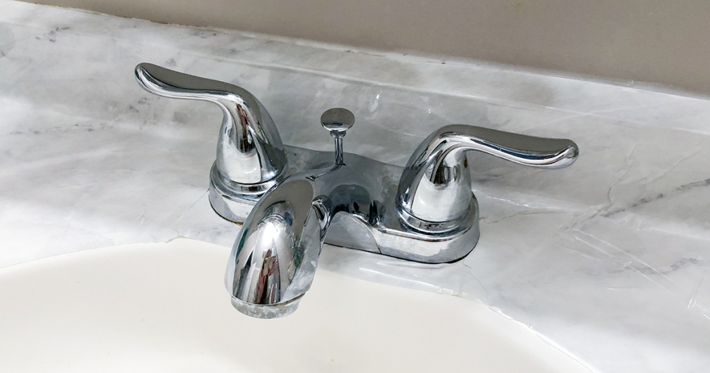 marble countertop diy - trim excess paper around faucet