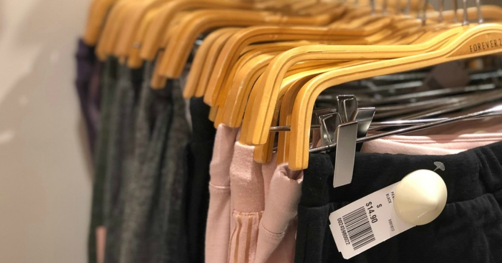 close up of pants on hangers in a store