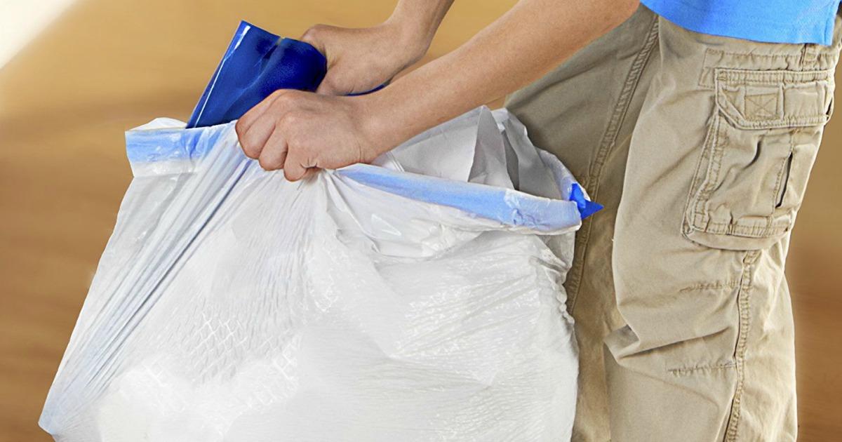 Person bagging up trash