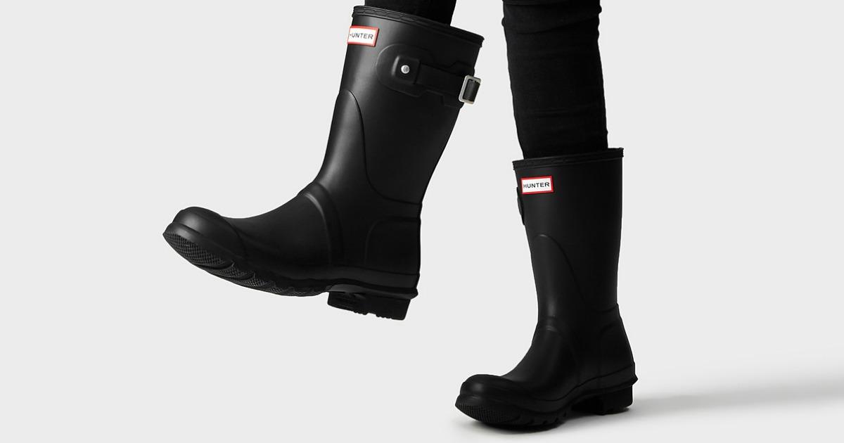 woman wearing black short hunter rain boots