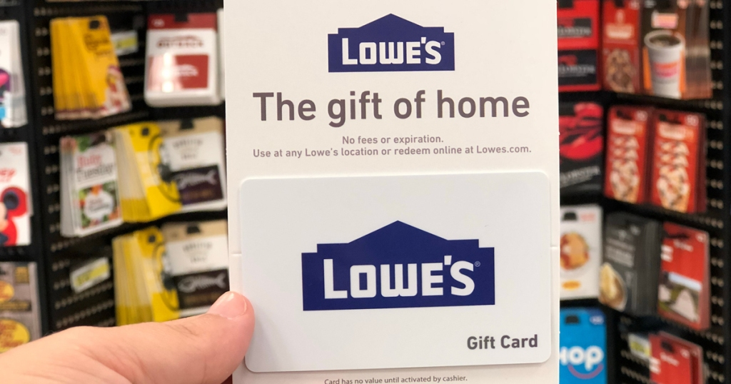 hand holding lowes gift card