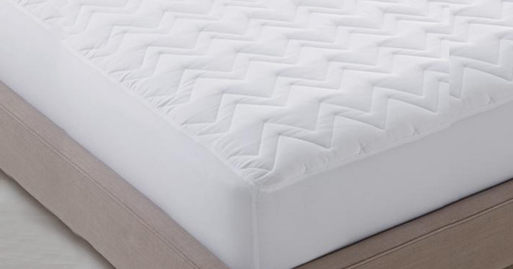 corner of Martha Stewart mattress pad