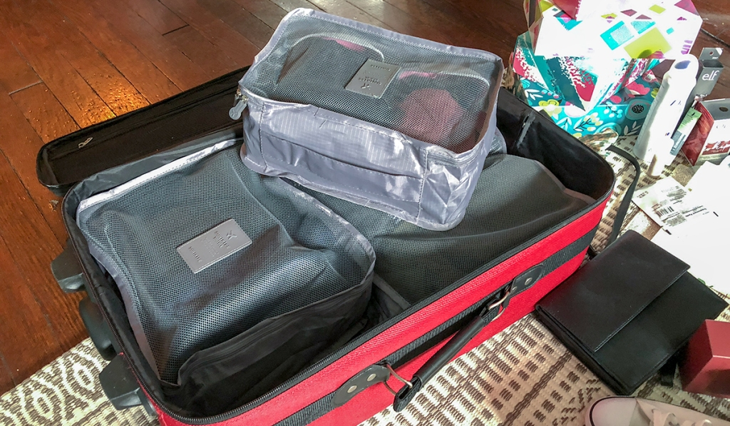 use packing cubes to organize outfits in your suitcase hip2save