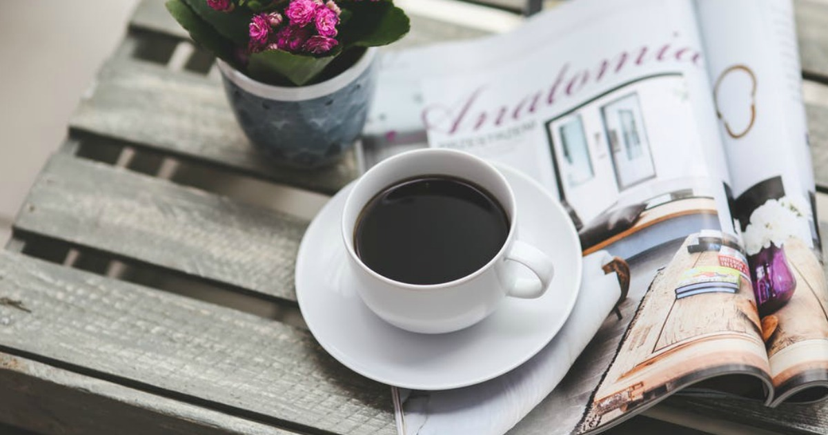 coffee cup and magazine on farm style table