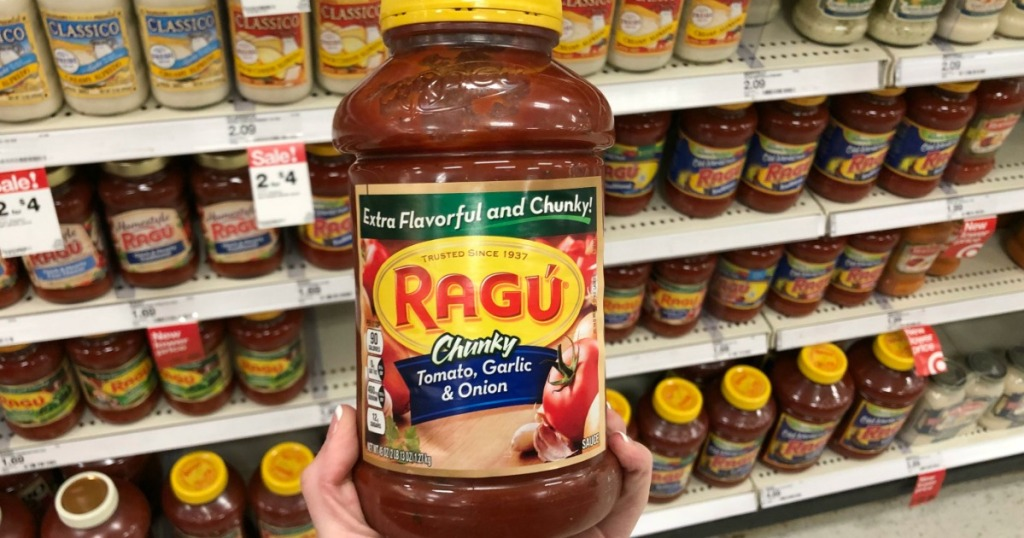 ragu chunky jar being held by hand in grocery store aisle