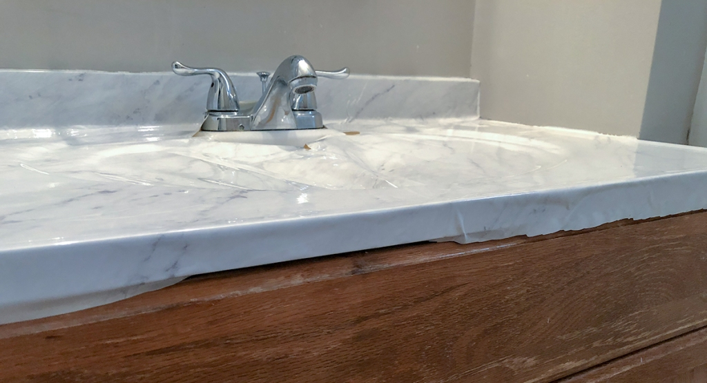 marble countertop DIY - roll and press paper over edges