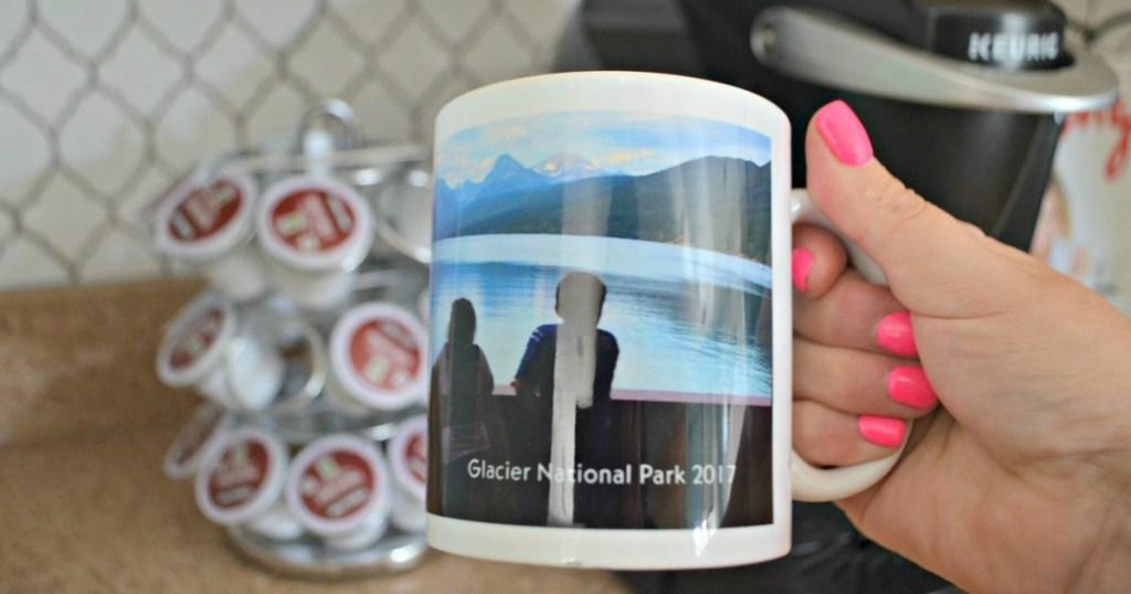jand holding a personalized shutterfly photo mug