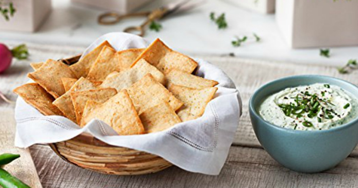 bowl of stacy's pita chips with dip on a table