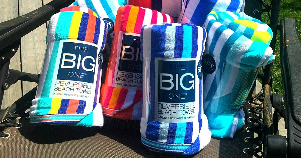 big beach towels in a variety of colors in a chair