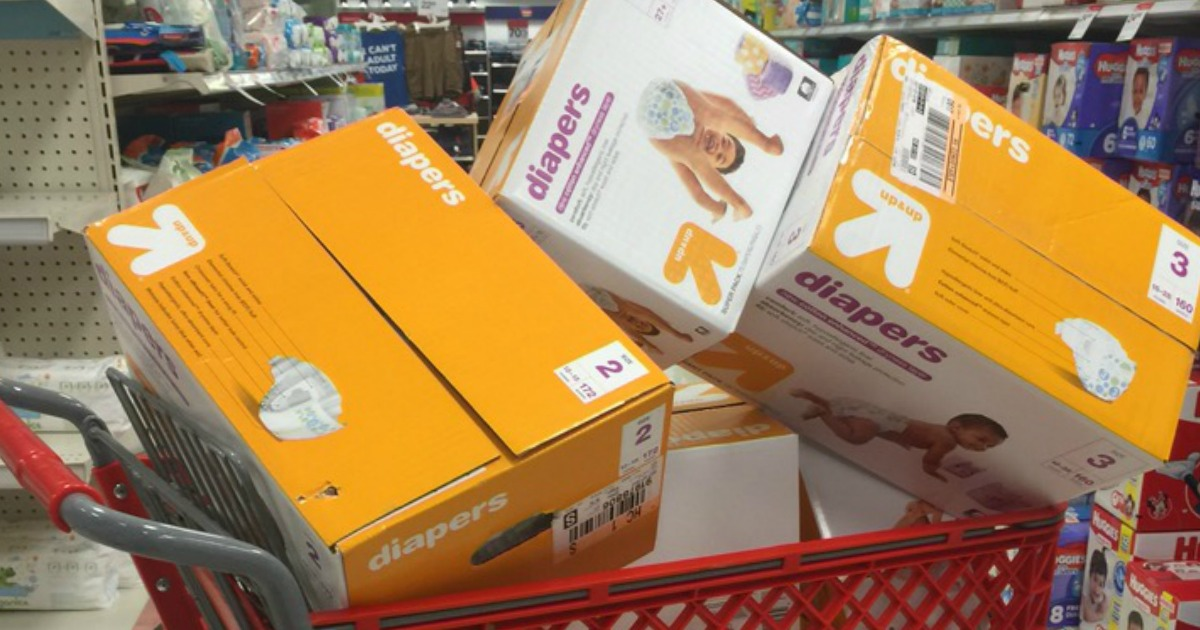 Large boxes of diapers in a red shopping cart in-store