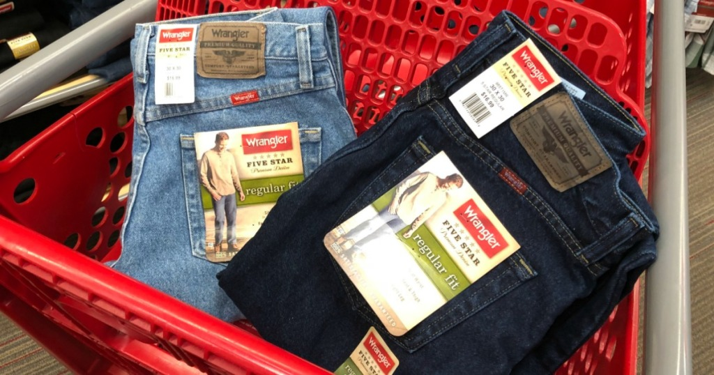 two pairs of mens jeans in a shopping cart