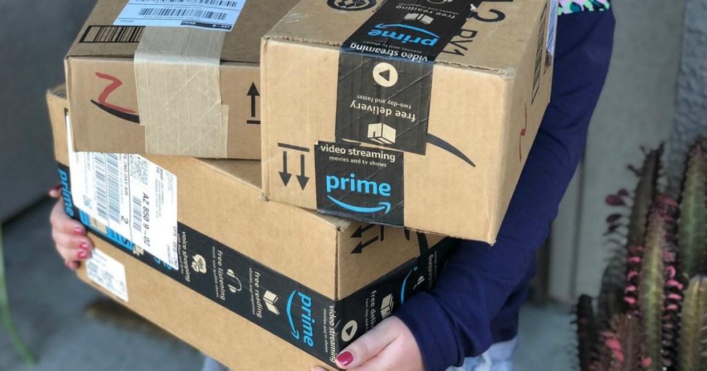 girl holding Amazon prime boxes