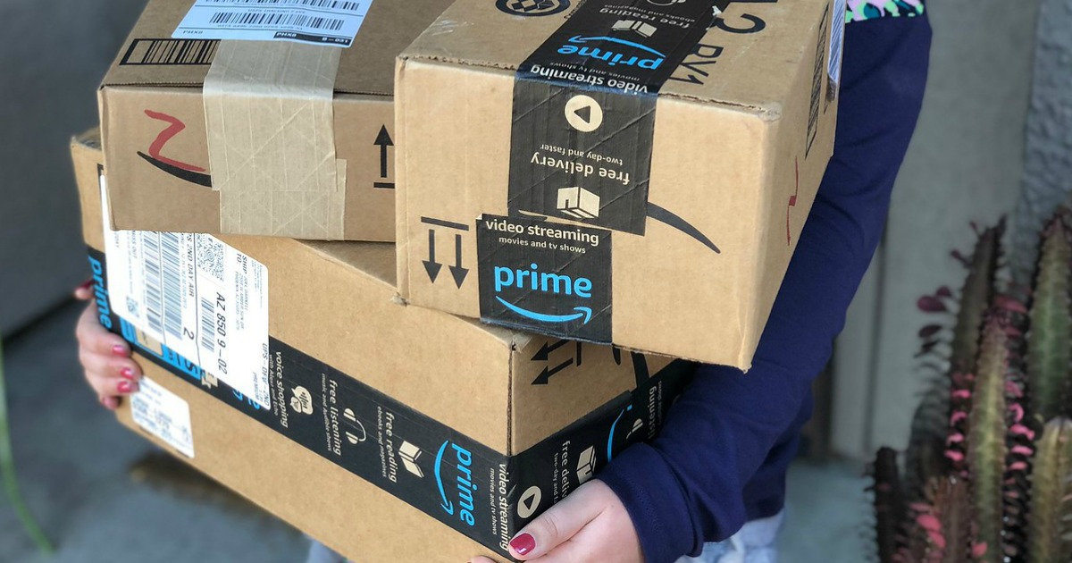 Amazon boxes in Collin's arms
