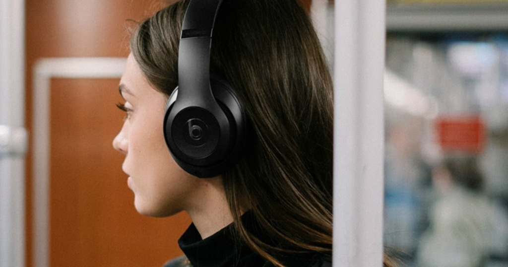 woman wearing black Beats headphones