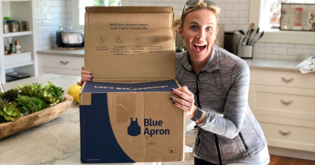 woman holding blue apron