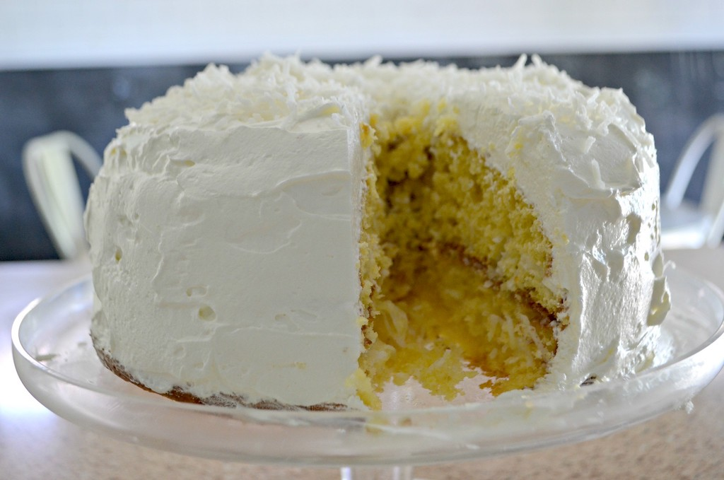 coconut cake with slice missing