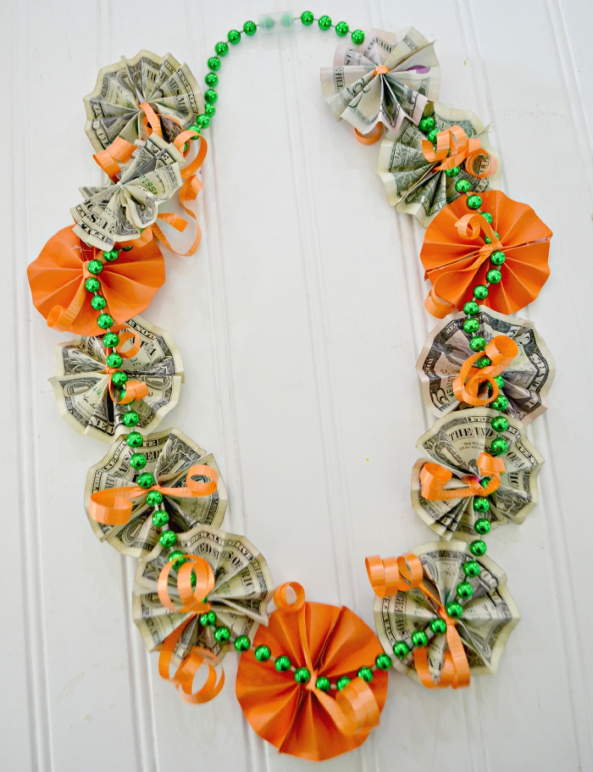 graduation money lei made from paper flowers and dollar bills