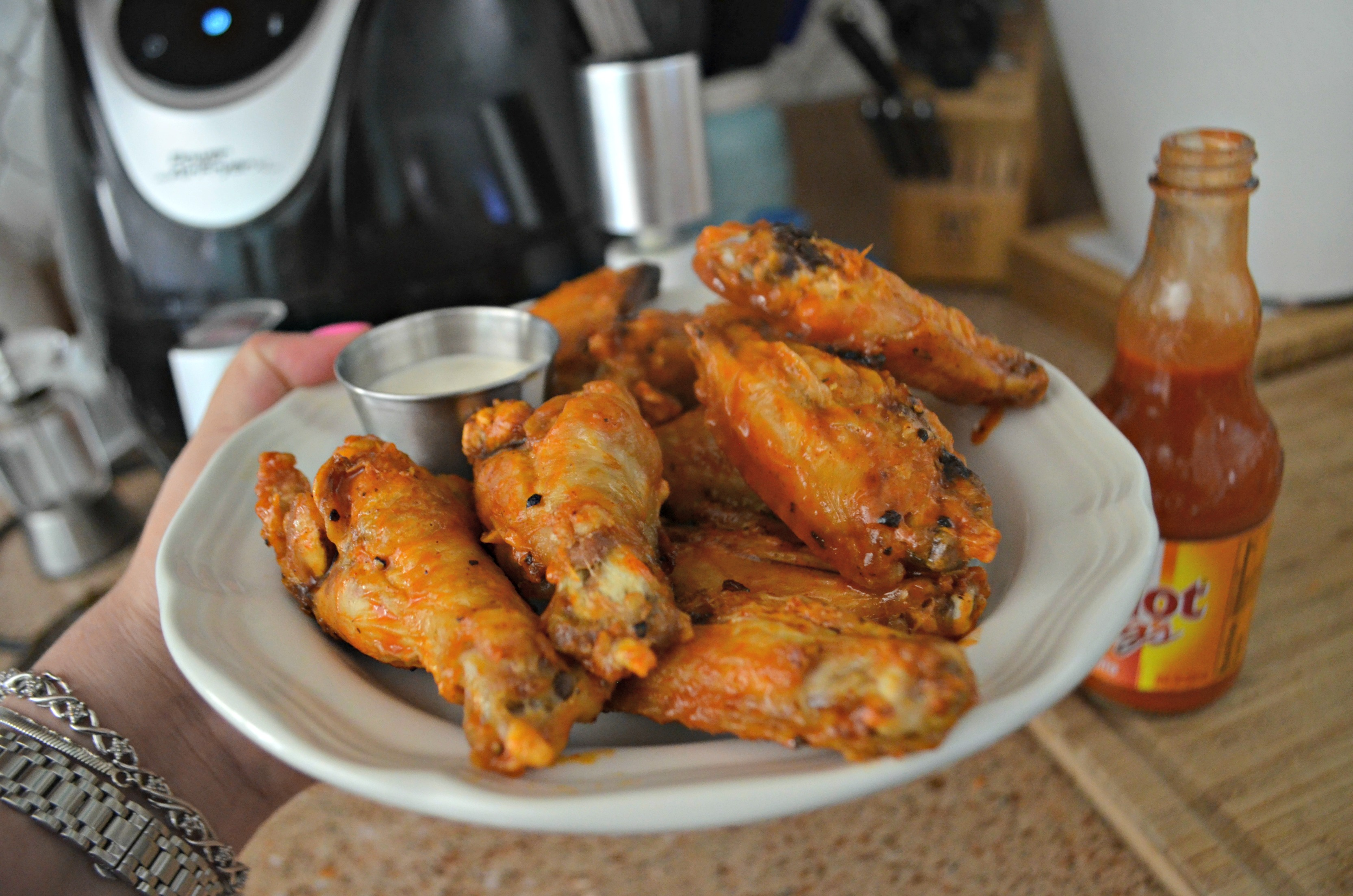 top kitchen cooking tools – air fryer and a plate of chicken wings