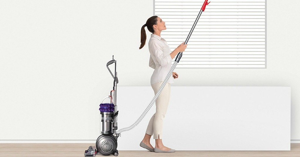 Woman vacuuming with a Dyson Animal vacuum