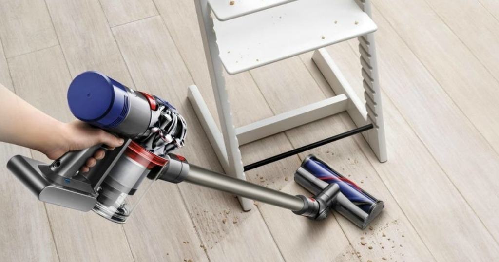 dyson v8 animal vacuum cleaning under a chair