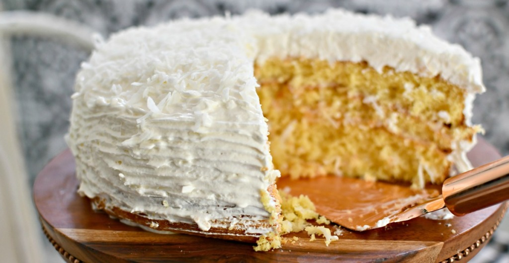 easy coconut cake on a cake stand
