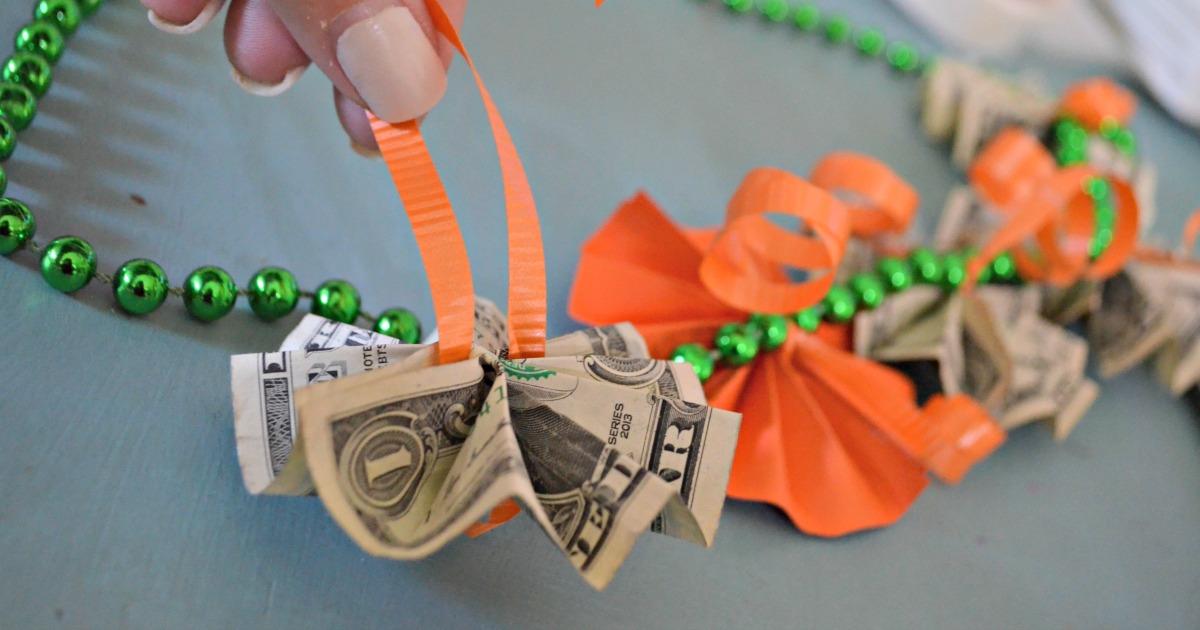 tying money to a graduation lei