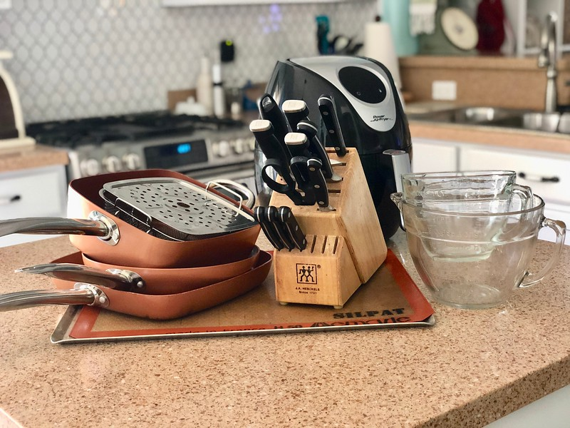 Lena's top kitchen cooking tools include pans, knives, Silpat, mixing bowls, and an air fryer