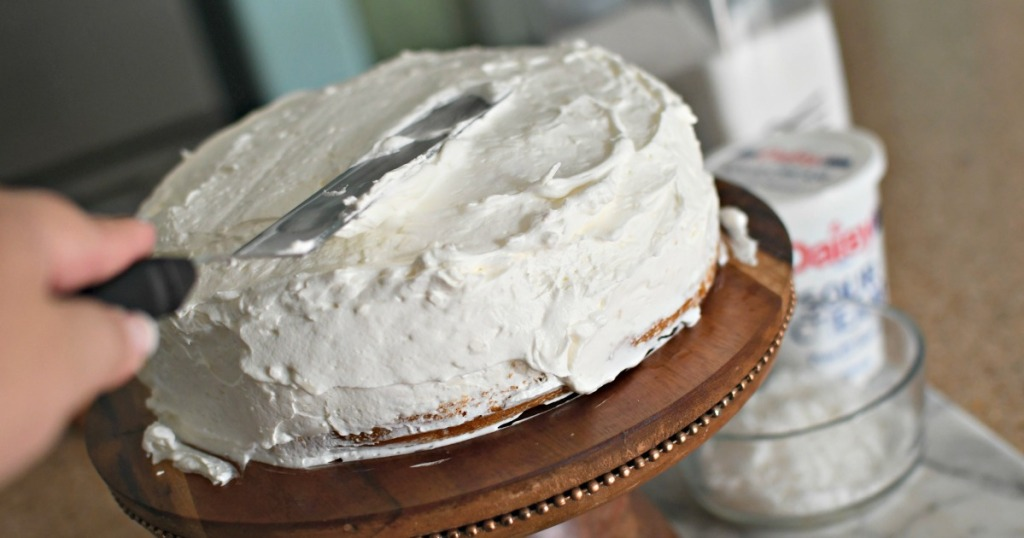 frosting a coconut cake with cool whip