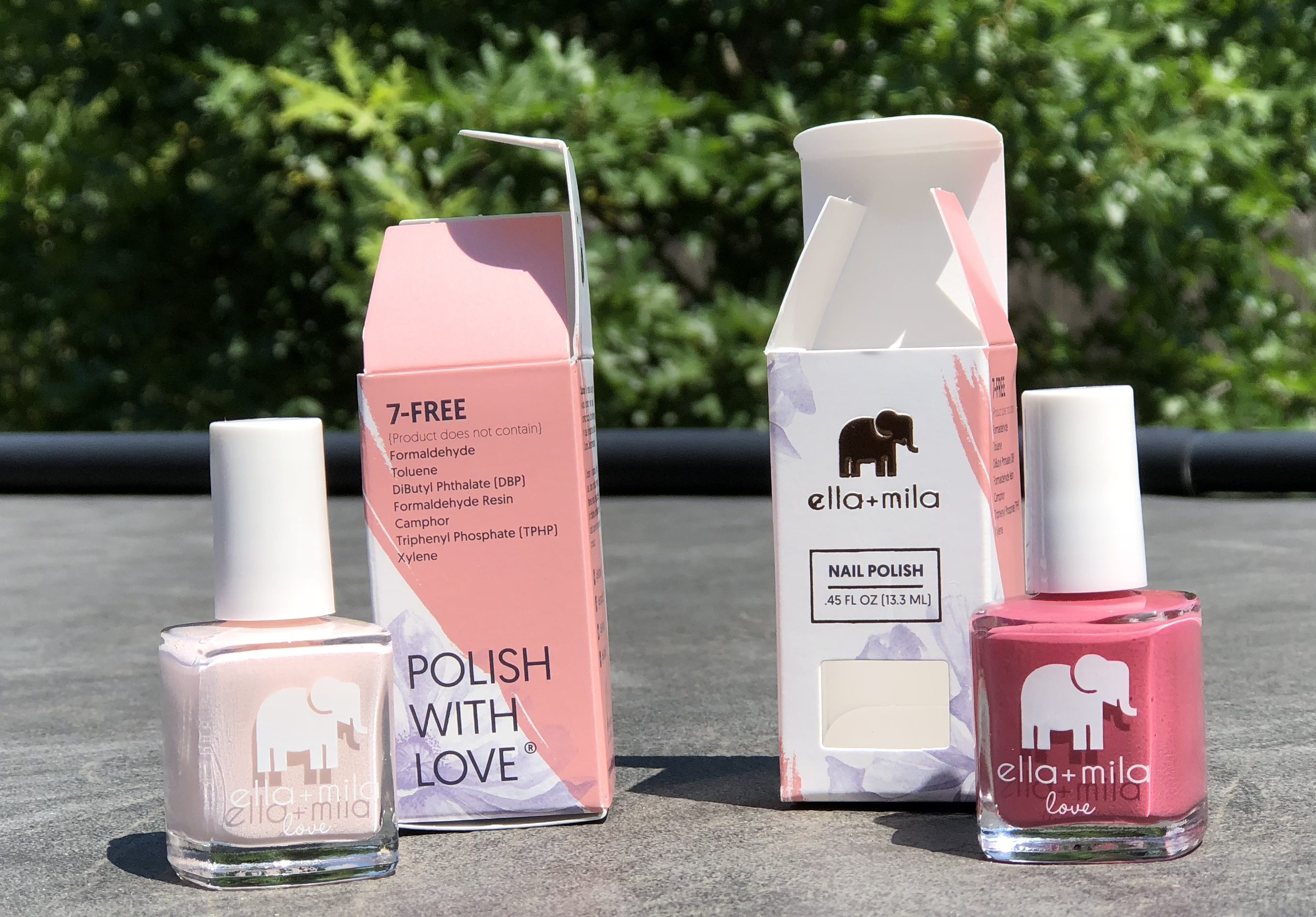 Ella+Mila promo codes are available on holiday nail sets – two bottles of nail polish next to their boxes